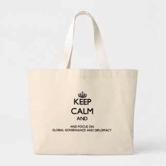Keep calm and focus on Global Governance And Diplo Tote Bags