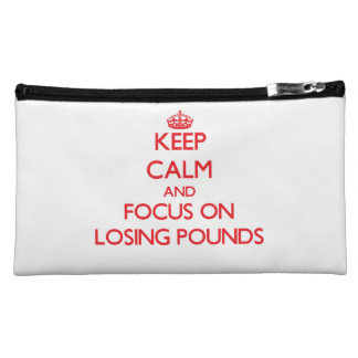 Keep Calm and focus on Losing Pounds Makeup Bags