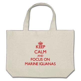Keep calm and focus on Marine Iguanas Canvas Bags