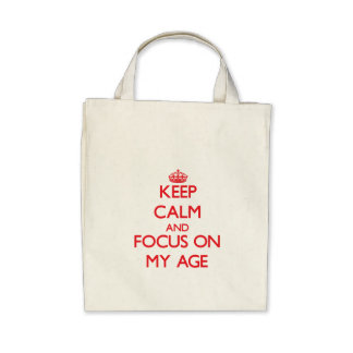 Keep calm and focus on MY AGE Tote Bags