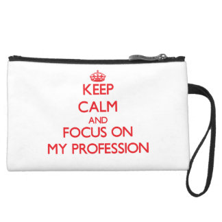 Keep Calm and focus on My Profession Wristlet Clutches