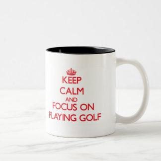 Keep Calm and focus on Playing Golf Mugs