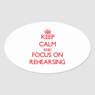 Keep Calm and focus on Rehearsing Oval Stickers
