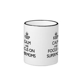 Keep Calm and focus on Supermoms Mugs