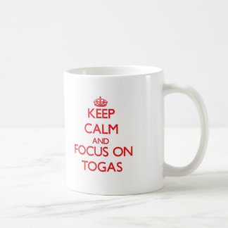 Keep Calm and focus on Togas Coffee Mugs