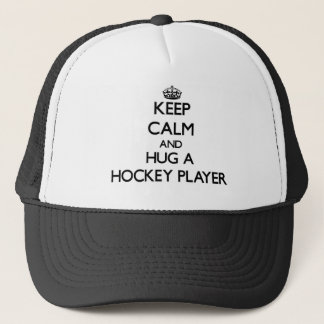 Keep Calm and Hug a Hockey Player Trucker Hat