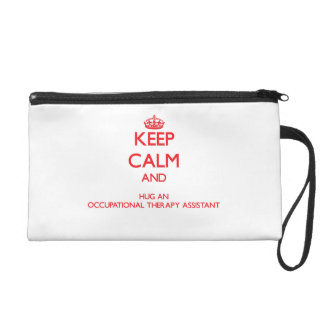 Keep Calm and Hug an Occupational Therapy Assistan Wristlet Clutches