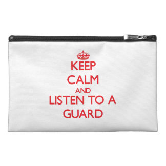 Keep Calm and Listen to a Guard Travel Accessory Bags