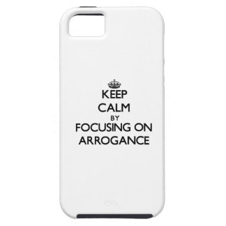 Keep Calm by focusing on Arrogance iPhone 5 Covers