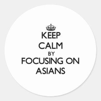 Keep Calm by focusing on Asians Round Sticker