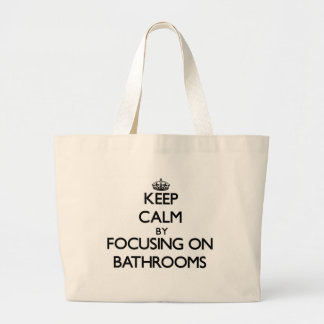 Keep Calm by focusing on Bathrooms Tote Bags