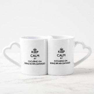 Keep Calm by focusing on Being Brain Damaged Lovers Mugs