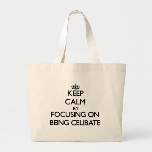 Keep Calm by focusing on Being Celibate Canvas Bags
