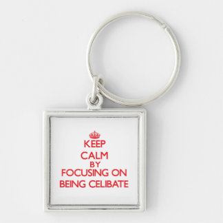 Keep Calm by focusing on Being Celibate Keychains