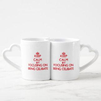 Keep Calm by focusing on Being Celibate Couple Mugs