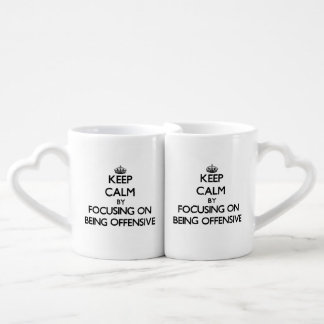 Keep Calm by focusing on Being Offensive Couples Mug