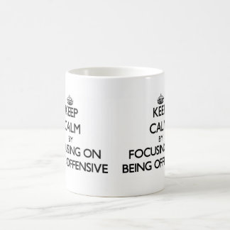 Keep Calm by focusing on Being Offensive Mugs