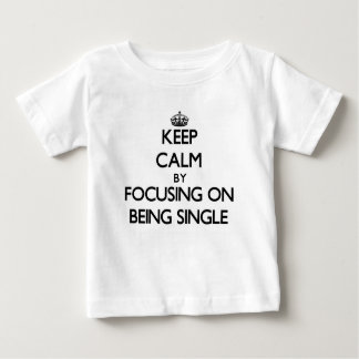 Keep Calm by focusing on Being Single Tee Shirts