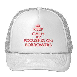 Keep Calm by focusing on Borrowers Trucker Hat