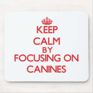 Keep Calm by focusing on Canines Mouse Pad
