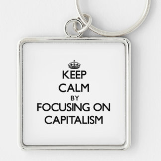 Keep Calm by focusing on Capitalism Keychains