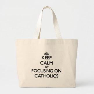 Keep Calm by focusing on Catholics Canvas Bag