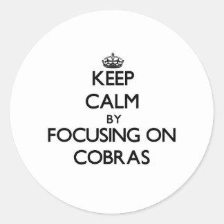 Keep Calm by focusing on Cobras Sticker