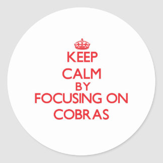 Keep Calm by focusing on Cobras Sticker