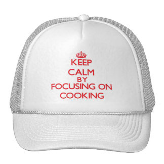 Keep Calm by focusing on Cooking Trucker Hat