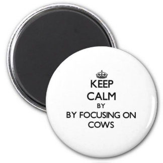 Keep calm by focusing on Cows Refrigerator Magnet