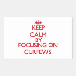 Keep Calm by focusing on Curfews Rectangular Sticker