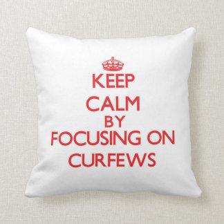 Keep Calm by focusing on Curfews Throw Pillows