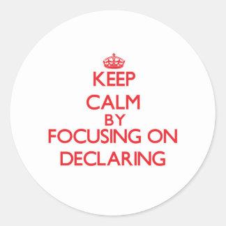 Keep Calm by focusing on Declaring Round Sticker
