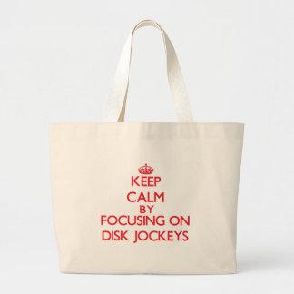 Keep Calm by focusing on Disk Jockeys Tote Bags