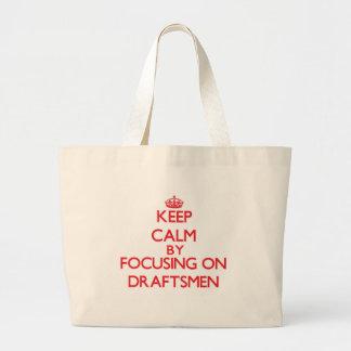 Keep Calm by focusing on Draftsmen Tote Bags