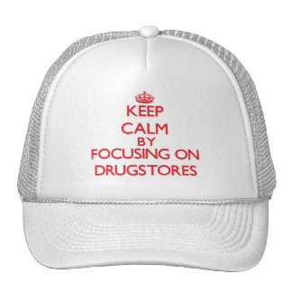 Keep Calm by focusing on Drugstores Trucker Hat