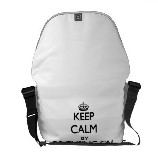 Keep Calm by focusing on Drunks Courier Bags