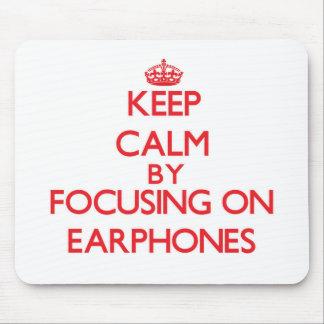 Keep Calm by focusing on EARPHONES Mousepad