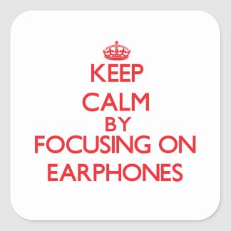 Keep Calm by focusing on EARPHONES Square Stickers