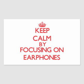 Keep Calm by focusing on EARPHONES Rectangle Stickers