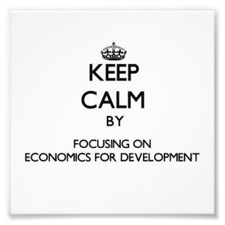 Keep calm by focusing on Economics For Development Art Photo