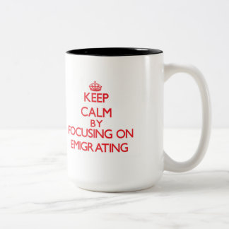 Keep Calm by focusing on EMIGRATING Mugs