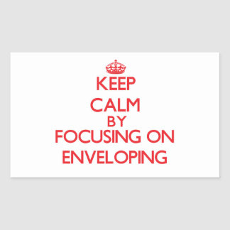Keep Calm by focusing on ENVELOPING Rectangular Sticker