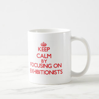 Keep Calm by focusing on EXHIBITIONISTS Basic White Mug