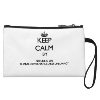Keep calm by focusing on Global Governance And Dip Wristlet Clutches