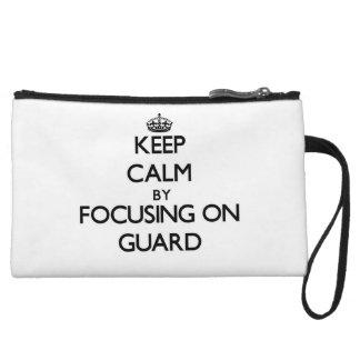 Keep Calm by focusing on Guard Wristlet Purses