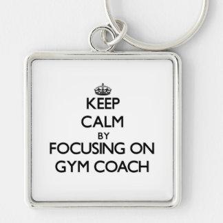 Keep Calm by focusing on Gym Coach Key Chains