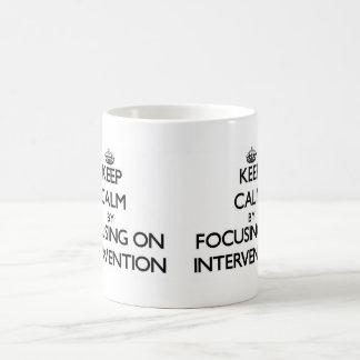 Keep Calm by focusing on Intervention Coffee Mugs