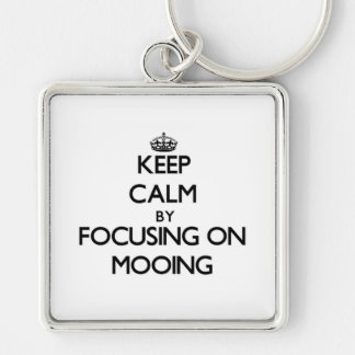 Keep Calm by focusing on Mooing Key Chains