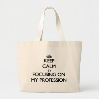 Keep Calm by focusing on My Profession Tote Bags